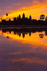 Angkor Wat and Reflection at Dawn. (baddoguy) Tags: ancient angkor architecture attraction attractive awakening backlit bright calendars cambodia cambodian civilization cloud color copyscpae culture dawn destination destinations dramatic empire famous glow good heritage historic historical history image international kmer landmark morning multicolor orange palace palm past postcard poster reap reflections royal ruins rural scenery seven siem silhouette site sites sky sunrise temple tourism tourist tranquility travel trees unesco vertical wat water window wonders world yellow