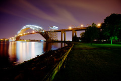 Bayonne Bridge (mudpig) Tags: longexposure bridge reflection tree night river geotagged newjersey construction shoreline dramatic images license getty statenisland hdr bayonne gettyimages lighttrail royaltyfree bayonnebridge mudpig killvankull stevekelley stevenkelley licensenow