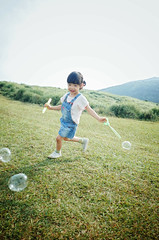 Oh Bubbles!! ( aikawake) Tags: light wild nature smile grass childhood children fun happy kid funny child play outdoor free happiness away run bubble overalls littlegirl moment ricohgr taiwanese pant suspender tirantes littlechild