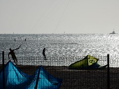 Windsurfing Shimmer (mikecogh) Tags: coast horizon sails silhouettes newcaledonia shimmer windsurfers noumea