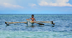 Young Captain (free3yourmind) Tags: child boy young captain sea ocean bohol philippines clouds cloudy boat local traditional
