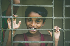 Enjoy your life.... (Ajwad Mohimin) Tags: child chittagong childportrit childportrait canon canon60d vintage bangladesh bangladeshi color red green tone toning face expression