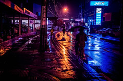 Day 319/366 : Rainy Street (hidesax) Tags: 319366 rainystreet reflections wet street lights orange blue car dealers night nightscape hidesax leica x vario 366project2016 366project 365project
