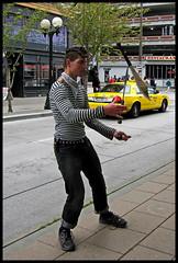 knife juggler (D G H) Tags: dgh daveheston downtown seattle streetphotography sidewalk candid city busker juggle knives streetperformer