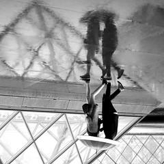 The accomplices (pascalcolin1) Tags: paris louvre pyramide pluie rain parapluie umbrella amies friends complices accomplices compres reflets reflection photoderue streetview urbanarte noiretblanc blackandwithe photopascalcolin carr square brilliant