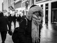 The Bleak Midwinter (Leanne Boulton) Tags: monochrome depthoffield people urban street candid portrait portraiture streetphotography candidstreetphotography candidportrait streetlife woman female pretty face facial expression look emotion mood atmosphere winter fur hood cold weather tone texture detail backlit bokeh natural outdoor light shade shadow city scene human life living humanity society culture canon 5d canoneos5dmarkiii 70mm character ef2470mmf28liiusm black white blackwhite bw mono blackandwhite glasgow scotland uk