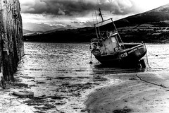 The Searcher (Missy Jussy) Tags: searcher welshcoast wales gwynedd trefor harbour sand boat sea seascape seaside coast shoreline sky clouds tyre rope mono monochrome blackwhite blackandwhite bw canon cannon600d 50mm canon50mm landscape moodylandscape atmosphere moody