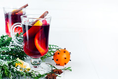 Mulled wine with cinnamon sticks (lyule4ik) Tags: mulled christmas drink food holiday hot cinnamon wine alcohol punch red spice table traditional white winter mandarin tangerine orange anise aromatic beverage grog heat ingredient refreshment rustic season seasonal tea walnut festive decoration photography homemade studio glass sugar delicious stick seasoning oranges gourmet copy dry bowl closeup isolated