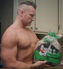 Whole grain bread for turkey leftovers (ddman_70) Tags: shirtless pecs muscle kitchen