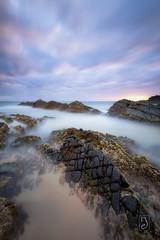 The Dragon Coast (.njep) Tags: australia canon1635mmf4 canon5dmarkiv crescenthead nsw sunrise landscape seascape wideangle longexposure leebigstopper color clouds rocks ocean fantasy