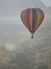 Ballon multicolore dans la brume -* (Titole) Tags: balloon hotairballoon titole nicolefaton mist montgolfiadesderocamadour montgolfire rocamadour thechallengefactory