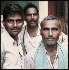 Portrait of three men (designldg) Tags: india indiasong uttarpradesh varanasi benares benaras kashi portrait men man sepiaandcolor smile square outdoor streetlife street streetphotography happiness maleportrait handsome expression emotion soul naturallight nostalgia composition atmosphere laurentgoldstein panasonicdmcfz200 photography people photoborder