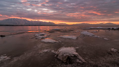 Winter Sunrise***EXPLORE*** (Adam's Attempt (at a good photo)) Tags: utah lake utahlake utahcounty utahlakesunrise water coldwater cold wet ice icy utahlakeice openwater morning mountains clouds cloudy colorful colorfulsunrise reflection reflections nikon d500 tokina 1116mm wideangle lightroom lr5 dng rocks haze snow utahsnow wintersunrise