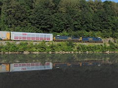 CSX 8530 and 215 (Trains & Trails) Tags: new railroad reflection water train diesel pennsylvania engine railcar transportation locomotive 215 csx autorack fayettecounty htm youghioghenyriver emd fxe ferromex 8530 darkfuture yn3 standardcab southconnellsville q21614