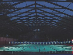 "drenched in blues (listening to ""growing up"", run river north) (jeneksmith) Tags: gloaming bluehour athletes sports twilight dusk night lines sky blue water lanes swimming swim pool canon"
