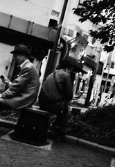 (a pendulum) (Dinasty_Oomae) Tags: minolta  minoltina  minoltinas s   tokyo   monochrome outdoor street bw blackwhite blackandwhite  akihabara  chiyodaku  kandasakumacho  smoking