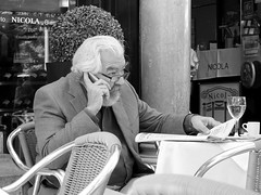 Phone call (52er Bild) Tags: lissabon nicola cafe portugal black white people mann fuji x10 bw lisboa strasencafe streetcafe oldman haar weises hair udosteinkamp rossio platz wein glas zeitung newspaper elegant schwarzweiss monochrom coffee fashion old classic chic bart haare