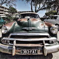 Metal grunge (Howard Ferrier) Tags: oceania gm australia rust chevrolet headlight bumperbar classiccar seq transport bonnet customcar chrome sunshinecoast happyvalley registrationplate car automotiveparts grille emblem caloundra motorvehicle queensland licenceplate numberplate spareparts vehicleparts