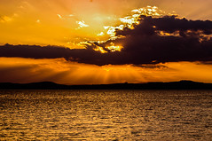 Beaming Sunset (Brian Travelling) Tags: sunset sunsetsandsilhouettes sundown sun sunbeams sunlight sunsets sunshine firthofclyde riverclyde clydecoast orange amber sky water seascape serene pentaxkr pentax pentaxdal peaceful
