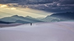 Lone Observer of the Majesty (Alan Amati) Tags: amati alanamati america american usa us southwest sw nm newmexico white whitesands whitesandsnationalmonument sand sands light streaks lone alone shilouette rays observer majesty sanandres sanandresmountains national park monument man watching dune dunes glory moiuntains mountain illuminated topf200