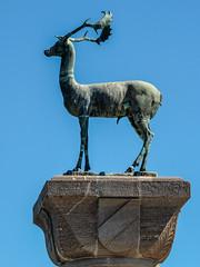 Bronze Stage Figure - Entrance to Rhodes Town Harbour ( Greece) (Olympus OMD EM5 &  Panasonic Lumix G 35-100mm f2.8 Zoom) (1 of 1) (markdbaynham) Tags: rhodes town harbour rhodos greece grecia greka greek hellas hellenic famous gr olympus omd em5 emem5 csc evil mirrorless m43 m43rd micro43 mft panasonic lumix g 35100mm f28