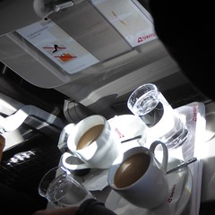 Coffee and water (prondis_in_kenya) Tags: kenya nairobi colddryseason flight swiss airplane aeroplane zurich zrich brussels bruxelles belgium belgique windowseat coffee water tray seat cup glass businessclass
