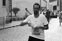 The Four Handed Runner (Rafael Pealoza) Tags: blackandwhite bw italy man byn water funny italia hand arms marathon trento runner halfmarathon giovanni trentohalfmarathon