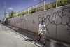 Downhill - 44th Avenue (David F. Panno) Tags: railroad usa newyork sony queens corona bicyclist lirr logisland dscrx100 28100mmf1849 downhill44thavenue