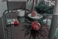after my morning cup (Haakon von Martinsky) Tags: cup coffee garden table granat punicagranatum granatäpfel