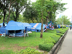 Lumphini Park in 2013 and the peoples army against the Taksin Regime took over the park with tents and meetings, Pathumwan District, Bangkok, Thailand. (samurai2565) Tags: pathumwan hualamphongrailwaystation bangkok thailand railwaysinthailand bangkokrailwaystation erawanshrine chitlom rama1road skytrain policehospital phloenchitroad lumphinipark