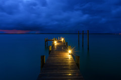 Tranquility in the Storm (Amy Hudechek Photography) Tags: long exposure pier florida storm clouds blue hour amyhudechek night gulfofmexico pensacola