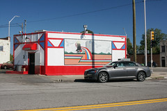 (Jeremy Whiting) Tags: gratiot detroit east side red blue sky bright no clouds chrysler 300 street scene michigan midwest urban inner city det 313 photography digital canon jeremy whiting sunlight afternoon autumn building painting hand painted