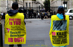`1821 (roll the dice) Tags: london westminster politics cameron whitehall downingstreet yellow chinese protest march sad mad funny people pilice natural gates fence primeminister sw1 coppers gun armed reckittbenckiser uk art classic urban england unaware unknown couple portrait strangers candid wisdom consumer hygiene peace traffic helmet glaxosmithkline korean killed murder dead madness conservative leader fashion shopping bored streetphotography voice thersamay canon tourism demo war
