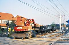 Once upon a time - The Netherlands - IJsselstein (railasia) Tags: holland provinceutrecht ijsselstein sun roadrailvehicle shovel utilityvehicle flatcar infra underconstruction eighties