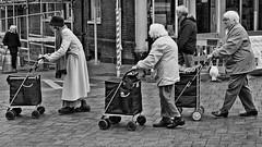 Girl's day out (sasastro) Tags: elderly women shoppingtrolleys mono street streetphotography