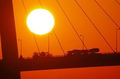 Car transport work (usotuki) Tags:           tsurumitubasbridge sunrise dawn morning glow crane bridge yokohama red pentaxk7 sigma50500mm1463apodg