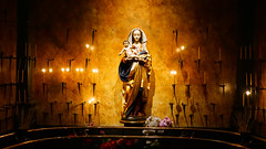 Blessed Virgin Mary at St James  Cathedral in Seattle Washington (paweesit) Tags: stjamescathedral seattle washington wa blessedvirginmary mary veneration catholic catholicchurch cathedral romancatholic christian christianity motherofgod marian wall candles lights candlelights virginmary holy sacred faith shrine statue jesus babyjesus interesting paweesit patweesit weesit interestingness