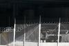 Delancey Street under the Williamsburg Bridge (Patja) Tags: barbed wire concertina razor chain link fence