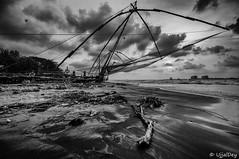 Chinese Fishing Net (ujjal dey) Tags: ujjal ujjaldey chinesefishingnet kochi fortkochi cochin kerala india godsowncountry travel tourist blackandwhite monochrome sea nets fishing sunset evening clouds leadingline
