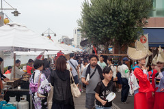 Festival hustle and bustle. (George Alexander Ishida Newman) Tags: street travel summer sky people food men colors festival japan buildings river festive photography photo tents dance interesting women colorful break dress cloudy traditional crowd performance hats straw stall busy drinks shikoku pedestrians kimono walls resting tokushima matsuri obon awaodori crowded vendors sensu