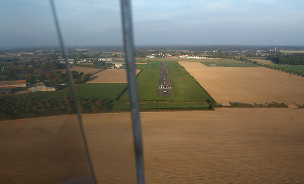 Final approach into L'Aigle St Michel in Normandy