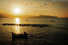 Barche al tramonto (Abdujaparov) Tags: sunset sea italy boat barca italia tramonto mare ship barche sicily palermo sicilia tailor bagheria seaman montepellegrino marinai aspra perfecteffects
