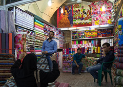 Man selling disney stuff i the clothes bazaar, Fars province, Shiraz, Iran (Eric Lafforgue) Tags: 4people adultsonly bazaar bazar business choice clothes colorimage colorful commerce disney fourpeople hanging historic horizontal indoors iran iranian market men mickeymouse middleeast multicolored people persia persian photography retail selling shiraz shop shopping shops store stores textile trade trading traveldestinations variation vendor woman farsprovince