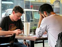 Neck Tattoo and Dumb Phone (knightbefore_99) Tags: merchants oyster bar seafood eastvan commercialdrive vancouver tasty cool best tattoo dumb stupid idiot retard neck cell idumb istupid