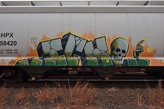 ICH (TheGraffitiHunters) Tags: graffiti graff spray paint street art colorful freight train tracks benching benched ich ichabod yme circle t skull hopper