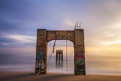 Abandoned Pier (Eunice Eunjin Oh) Tags: davenportpier abandonedpier bridge santacruz longexposure outdoorphotography sunset storm rain cabrillohwy californiastatepark beach leefilter