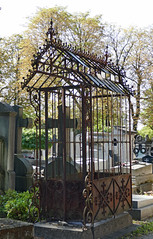 Quaint old iron and glass cover over a grave (Monceau) Tags: cimetireduprelachaise quaint iron glass house cover grave