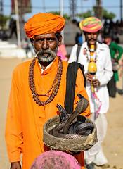 Snake charmer (Mivr) Tags: india pushkar rajasthan man snake cobra charmer rudraksha