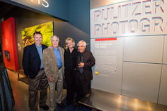 PRONewseum The four Pulitzer-Prize winning photographers and the evening's panelists: Smiley Pool, Robert Jackson, Carol Guzy and Nick Ut at the entrance of the Pulitzer Prize Photographs Gallery.