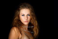 Barbed Wire Caroline (Bad-Duck) Tags: youngwoman woman barbed wire studio flash light beauty beautiful bare shoulders